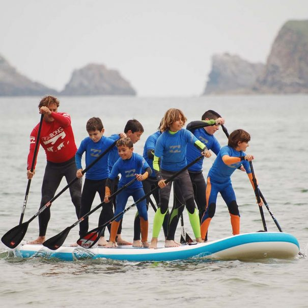 big sup en los locos surf school suances travesia en paddel la concha